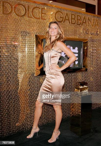 Model Gisele Bundchen makes an instore appearence at SAKS Fifth Avenue during the Dolce and Gabbana Launch of 'The One' Fragrance by Dolce and...