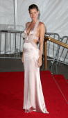 Model Gisele Bundchen poses as she departs from the Metropolitan Museum of Art Costume Institute Gala Superheroes Fashion and Fantasy held at the...