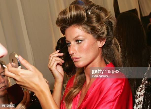 Model Gisele Bundchen prepares backstage for The Victoria's Secret Fashion Show at the 69th Regiment Armory November 9 2005 in New York City