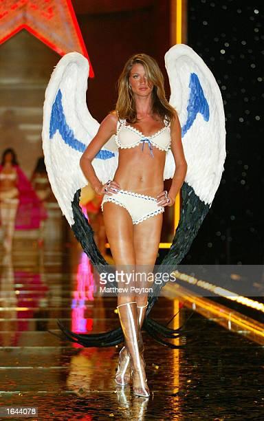 Model Gisele Bundchen walks the runway at the Victoria Secret Fashion Show at the Lexington Avenue Armory November 14 2002 in New York City New York