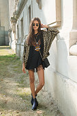 Model Gizele Oliveira is wearing Rayban sunglasses Harley Davidson tshirt vintage jacket and bag and Kurt Geiger shoes on day 8 of Paris Collections...
