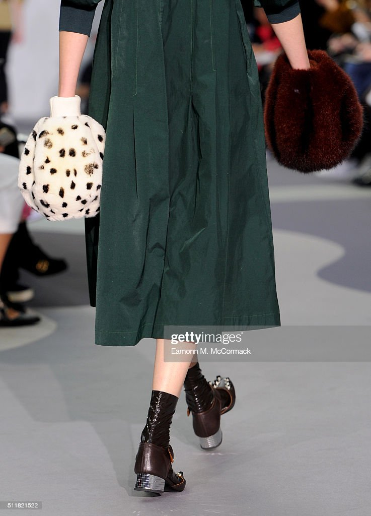 A model glove detail walks the runway at the Toga show during London Fashion Week Autumn/Winter 2016/17 at Brewer Street Car Park on February 23 2016...