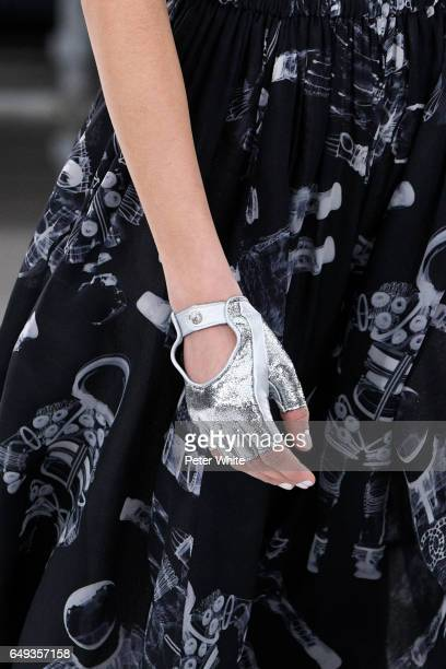A model glove detail walks the runway during the Chanel show as part of the Paris Fashion Week Womenswear Fall/Winter 2017/2018 on March 7 2017 in...