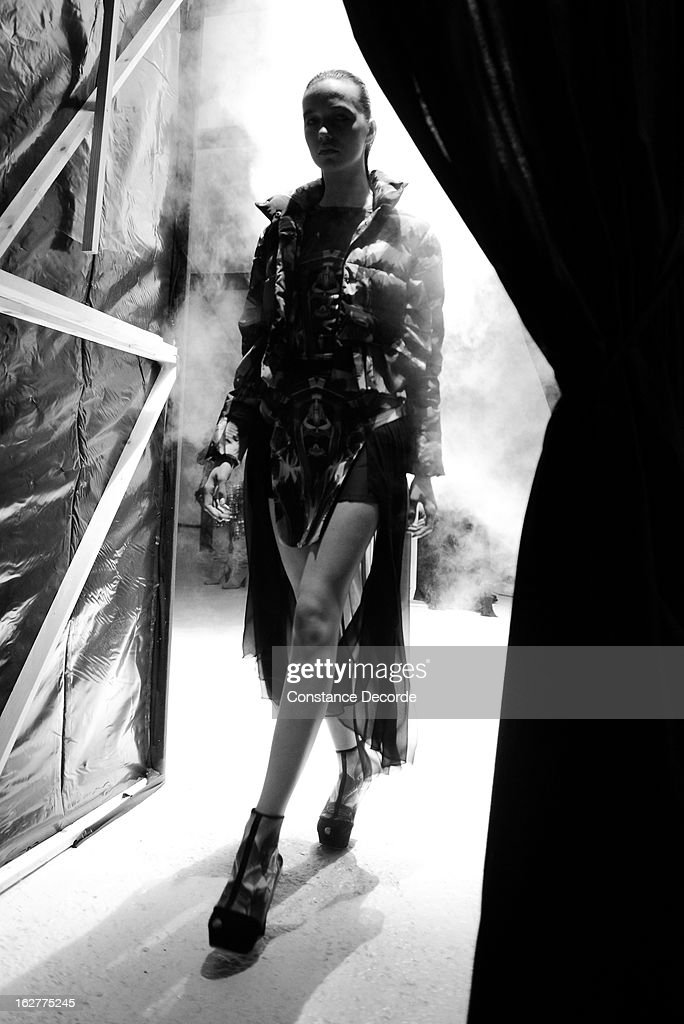 A model goes out the runway during the Ground Zero Fall/Winter 2013 Ready-to-Wear show as part of Paris Fashion Week on February 26, 2013 in Paris, France.