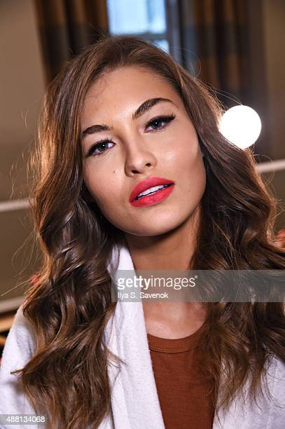 Model Grace Elizabeth prepares backstage at the Sherri Hill Spring 2016 fashion show during New York Fashion Week at The Plaza Hotel on September 13...