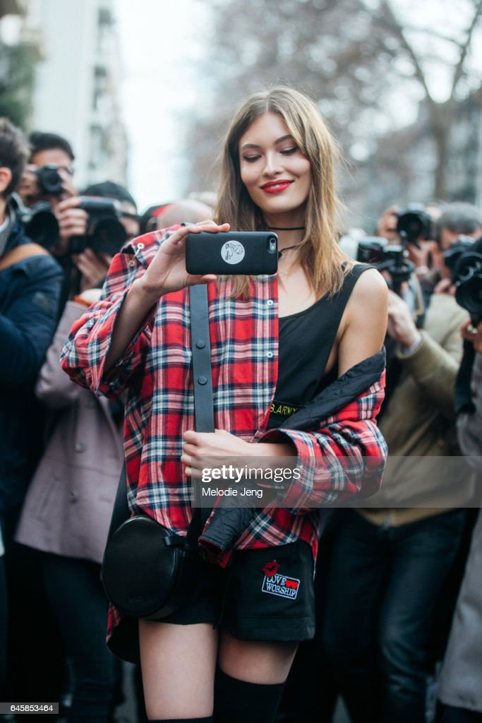 Model Grace Elizabeth takes a photo of the photographers outside Dolce & Gabbana during Milan Fashion Week Fall/Winter 2017/18 on February 26, 2017 in Milan, Italy.