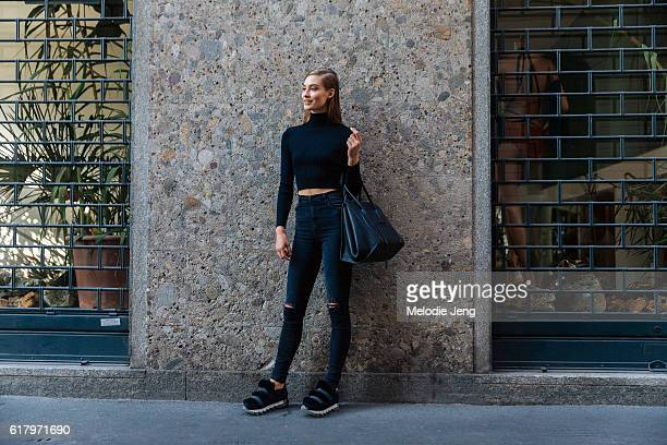 Model Grace Elizabeth wears an allblack outfit including a cropped turtleneck top Celine purse jeans and furry Dolce Gabanna sneakers after the...
