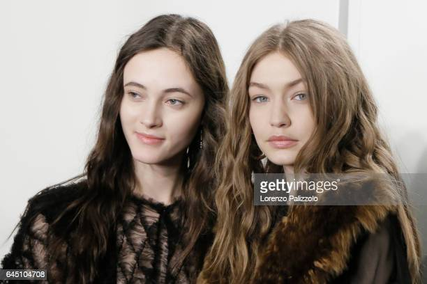 Model Greta Varlese and Gigi Hadid are seen backstage ahead of the Fendi show during Milan Fashion Week Fall/Winter 2017/18 on February 23 2017 in...