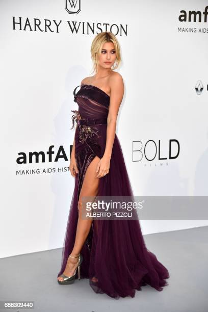 US model Hailey Baldwin poses as she arrives for the amfAR's 24th Cinema Against AIDS Gala on May 25 2017 at the Hotel du CapEdenRoc in Cap d'Antibes...