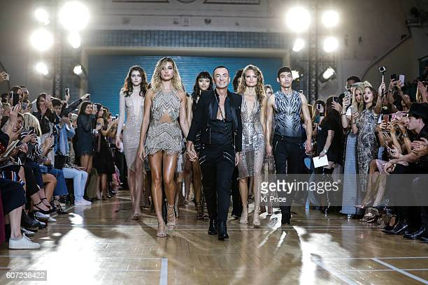Model Hailey Baldwin walks with designer Julien Macdonald on the runway at the Julien Macdonald show during London Fashion Week Spring/Summer...