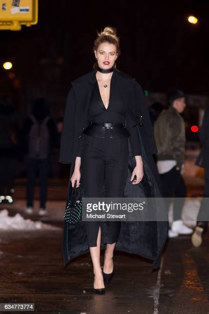 Model Hailey Clauson is seen wearing Saint Laurent jumpsuit coat and shoes Zana Bayne belt Alexander Wang bag Gigi et Joux choker and Lauren Klassen...