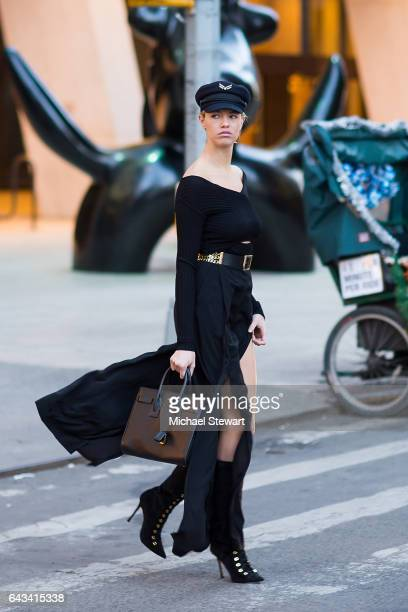Model Hailey Clauson is seen wearing Tommy x Gigi hat DSQUARED2 belt Cinq a Sept pants and Saint Laurent bag and boots in Midtown on February 20 2017...