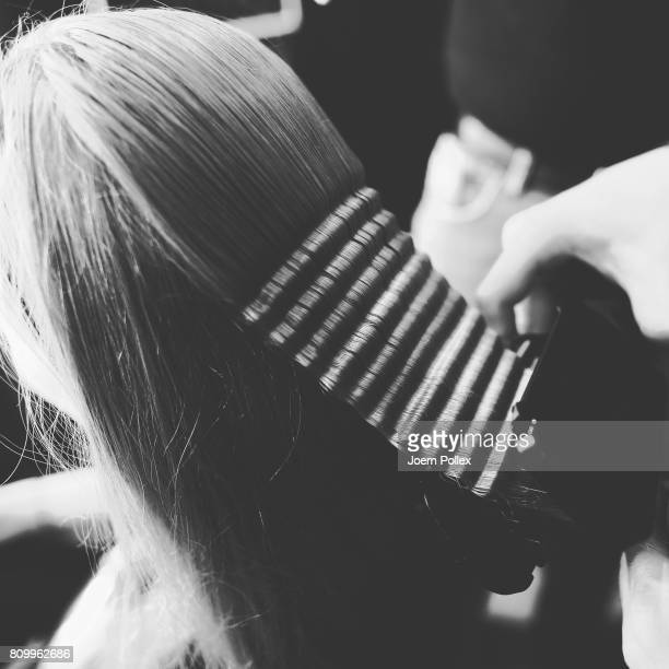 A model hair detail gets prepared backstage ahead of the Steinrohner show during the MercedesBenz Fashion Week Berlin Spring/Summer 2018 at Kaufhaus...