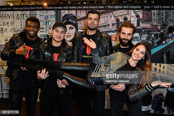 Model Hana Nitsche poses with break dancers during the Freaky Nation 'Hana Nitsche NYC' campaign presentation at Panorama tradeshow on January 18...