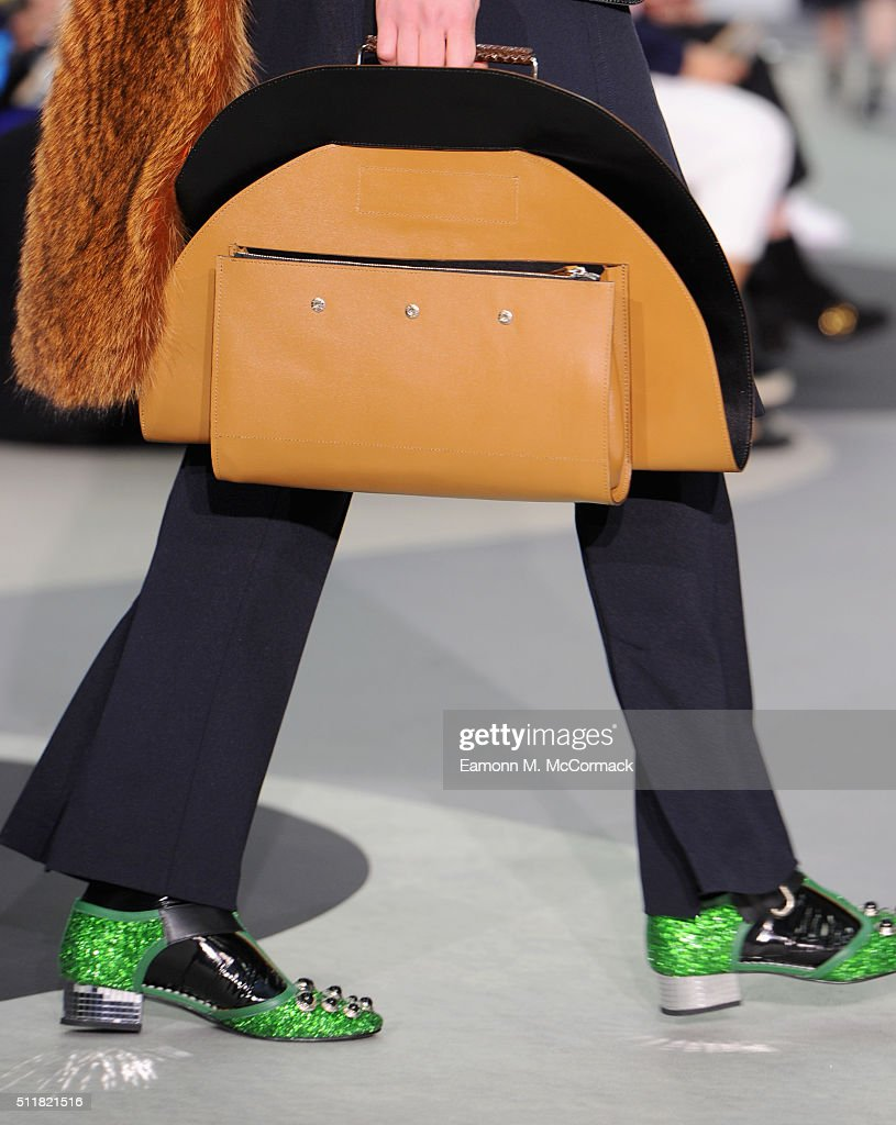 A model handbag detail walks the runway at the Toga show during London Fashion Week Autumn/Winter 2016/17 at Brewer Street Car Park on February 23...