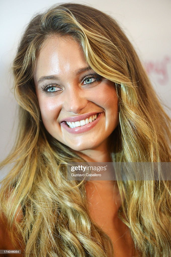Model Hannah Davis prepares backstage with TRESemme at the Beach Bunny show during Mercedes-Benz Fashion Week Swim 2014 at Cabana Grande at the Raleigh on July 19, 2013 in Miami, Florida.