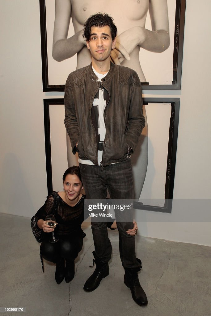 Model Hannah Doersken (L) and Nick Simmons attend the Samuel Bayer Ace Gallery Exhibit Opening, presented by Panavision at Ace Gallery on March 2, 2013 in Beverly Hills, California.