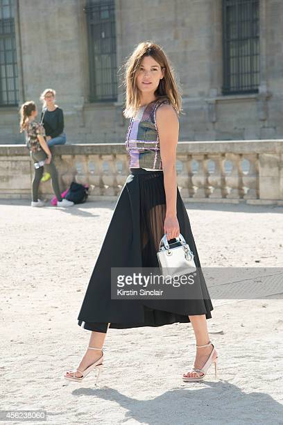 Model Hanneli Mustaparta is wearing a Dior bag top skirt and shoes on day 4 of Paris Collections Women on September 26 2014 in Paris France