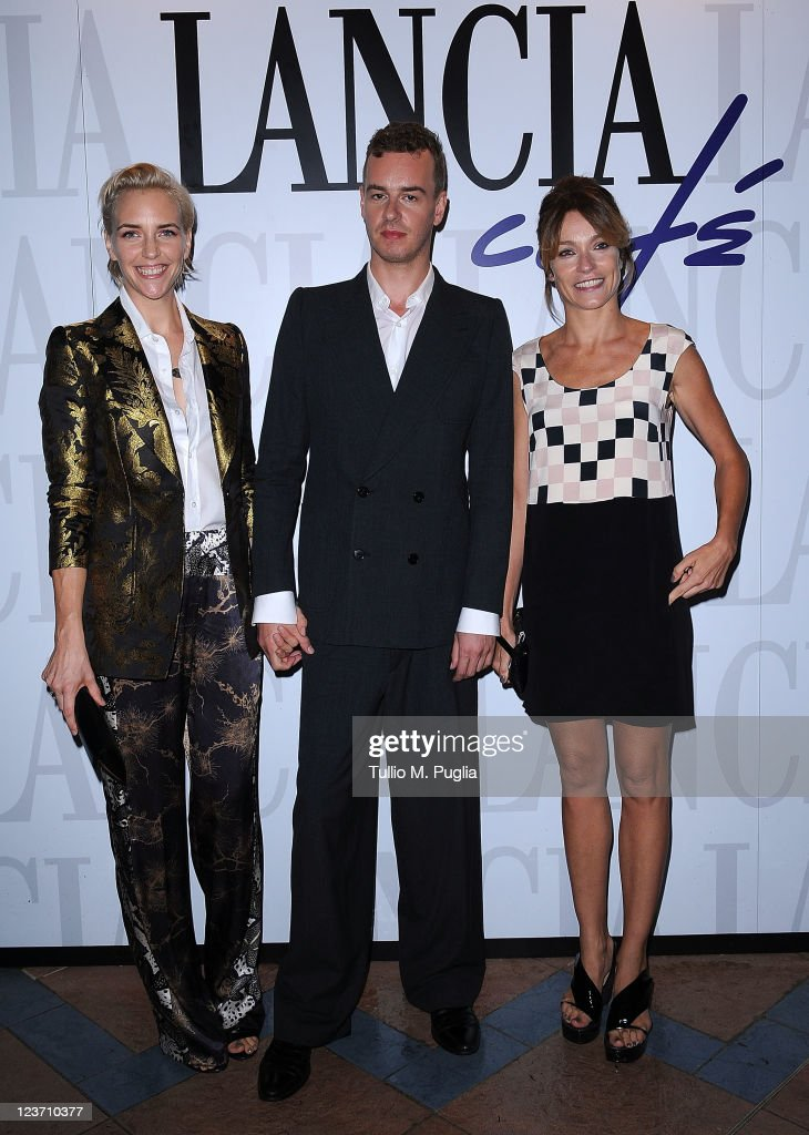 Model Hannelore Knuts filmmaker Nicolas Provost and actress Stefania Rocca visit the Lancia Cafe during the 68th Venice Film Festival on September 4...