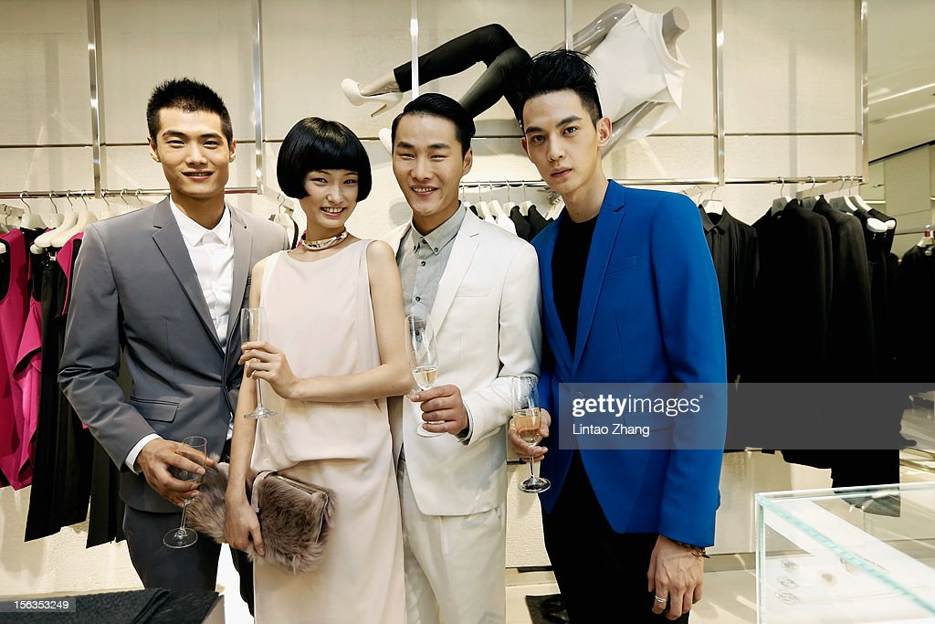 Model Hao Yunxiang,Wang Xiao,Li Zhen and Tang Xiaotian pose for picture during the Fall 2012 Presentation at ck Calvin Klein store in Oriental Plaza on November 13, 2012 in Beijing, China.