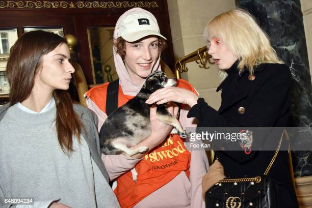 A model Harold Vnt his dog Dog Lemi and model Zlata Semenko attend the Vivienne Westwood Show as part of the Paris Fashion Week Womenswear...