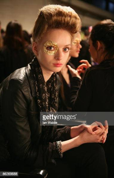 A model has gold leaf eye makeup applied backstage ahead of the Konstantina Mittas catwalk show at the Overseas Passenger Terminal Circular Quay on...