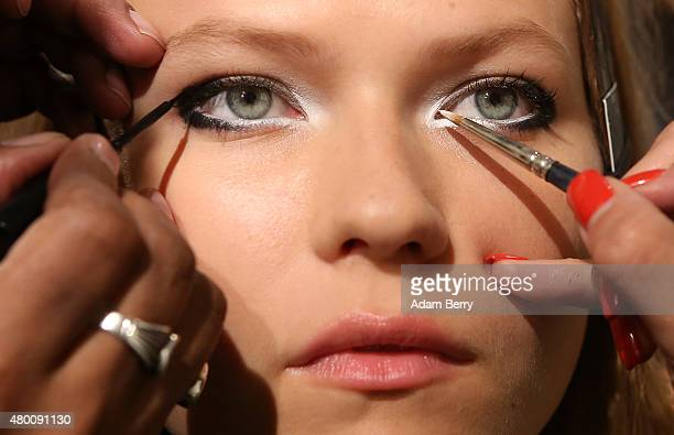 A model has her eye makeup applied prior to the Augustin Teboul show during MercedesBenz Fashion Week Berlin Spring/Summer 2016 at the Galerie Judin...