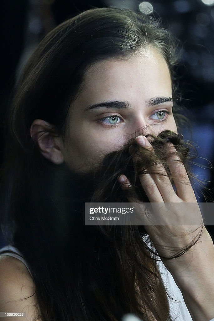 A model has her hair and maeup done backstage ahead of the during the Audi Star Creation Capsule Showcase on May 17, 2013 in Singapore.