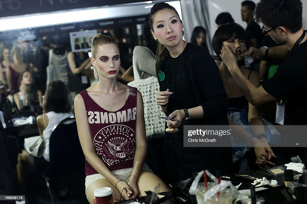 A model has her hair and makeup done backstage ahead of the Audi Star Creation Capsule Showcase on May 17, 2013 in Singapore.