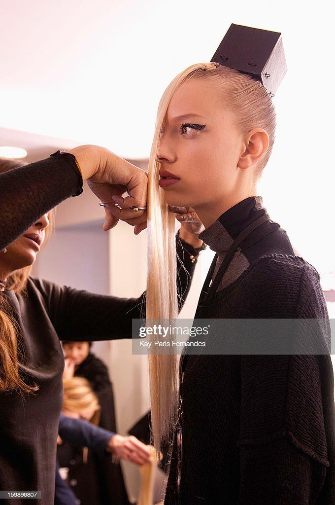 A model has her hair done backstage at the Julien Fournie Spring/Summer 2013 Haute-Couture show as part of Paris Fashion Week at Cite de l'Architecture et du Patrimoine on January 22, 2013 in Paris, France.