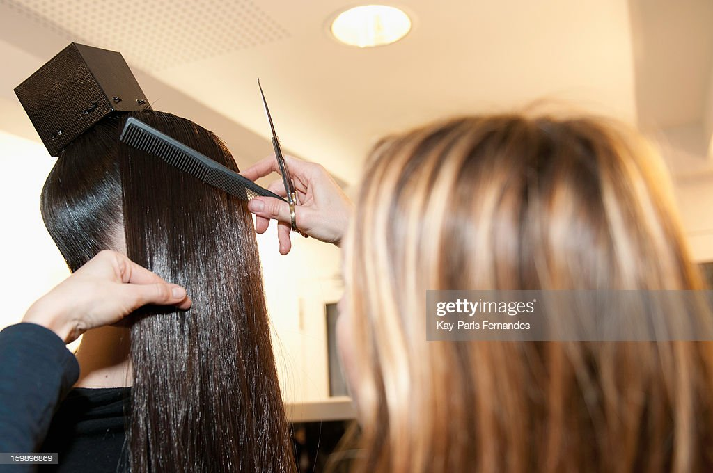 A model has her hair done backstage Julien Fournie Spring/Summer 2013 Haute-Couture show as part of Paris Fashion Week at Cite de l'Architecture et du Patrimoine on January 22, 2013 in Paris, France.