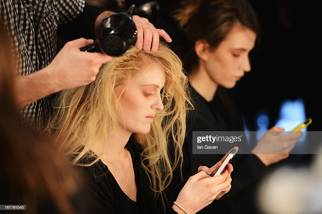 A model has her hair styled backstage at the John Rocha show during London Fashion Week Fall/Winter 2013/14 at Somerset House on February 16, 2013 in London, England.