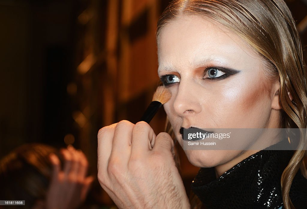 A model has her make up applied backstage at the Dans La Vie show during London Fashion Week Fall/Winter 2013/14 at Freemasons Hall on February 16, 2013 in London, England.