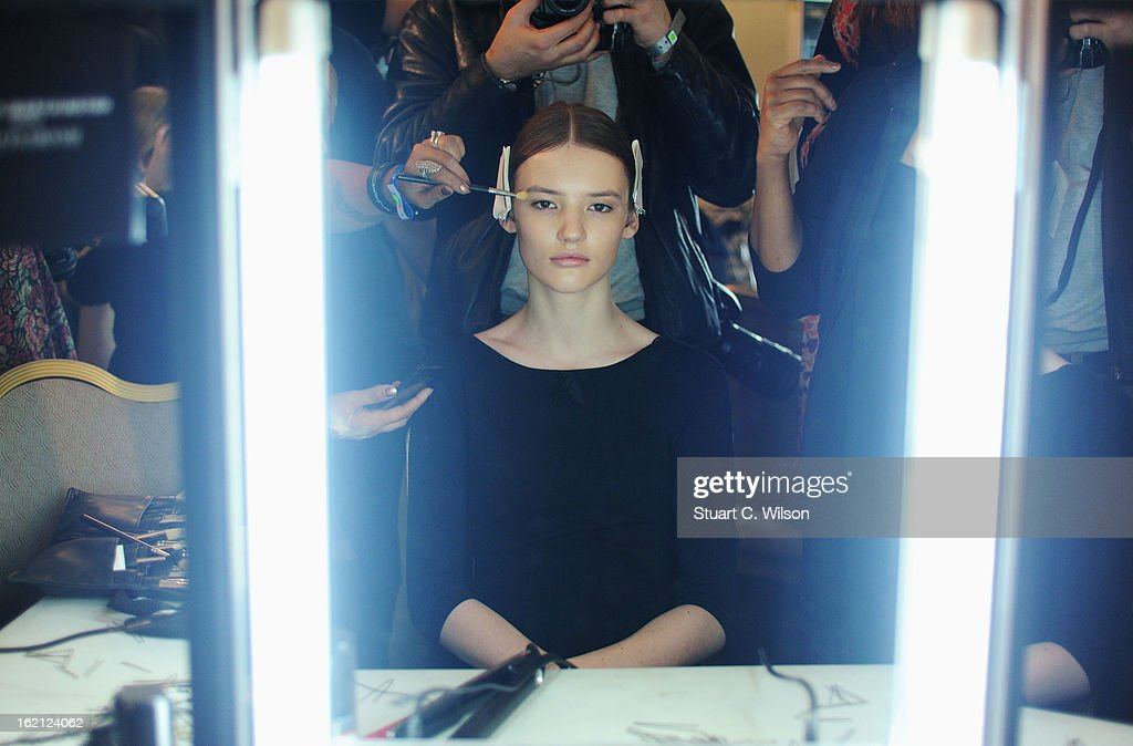A model has her make up applied backstage at the Roksanda Ilincic show during London Fashion Week Fall/Winter 2013/14 at The Savoy on February 19, 2013 in London, England.