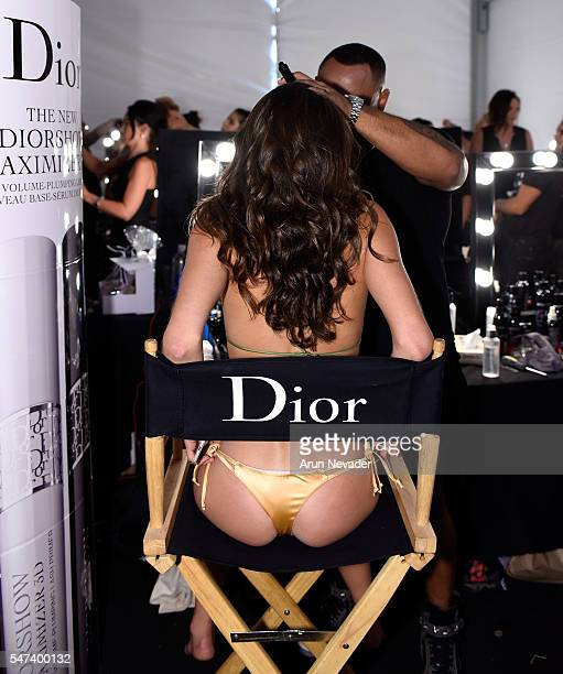 A model has her makeup done backstage by Dior Cosmetics at Art Hearts Fashion Miami Swim Week Presented by AIDS Healthcare Foundation at Collins Park...