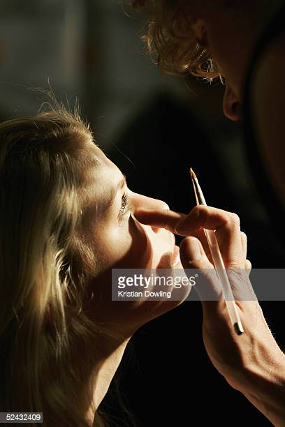 A model has her makeup done before walking down the catwalk during the L'Oreal Paris Runway 3 of the L'Oreal Fashion Festival at Federation Square...