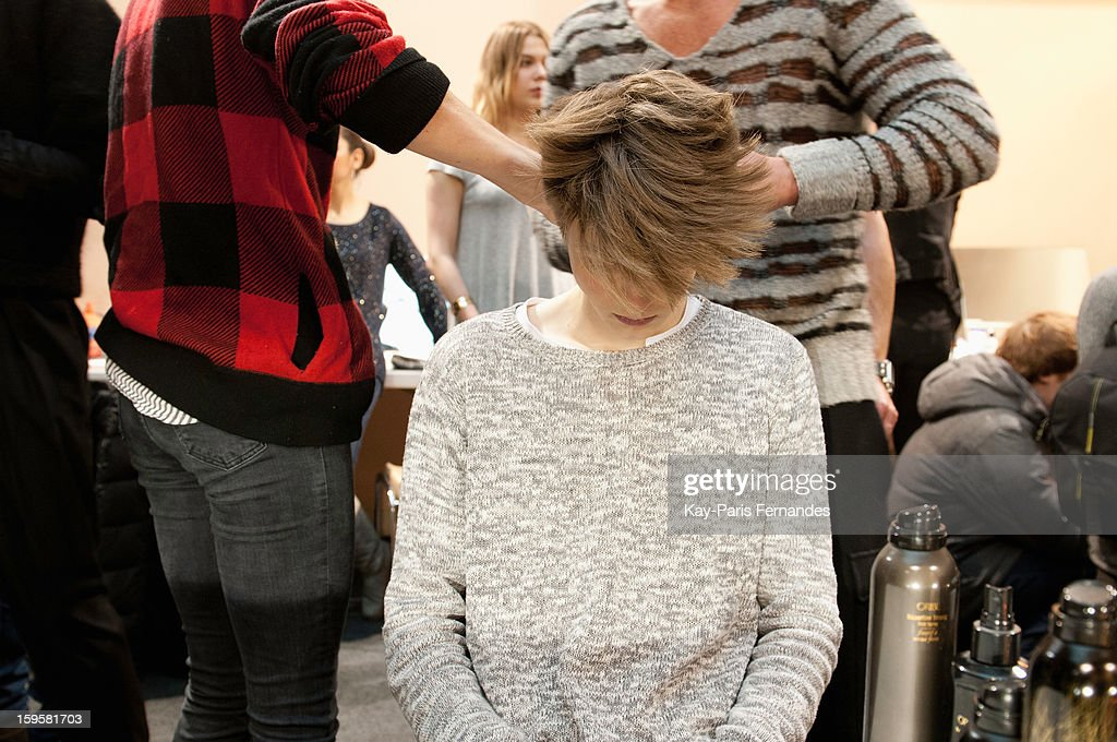 A model has his hair styled backstage during the John Lawrence Sullivan Men Autumn / Winter 2013 show as part of Paris Fashion Week on January 16, 2013 in Paris, France.