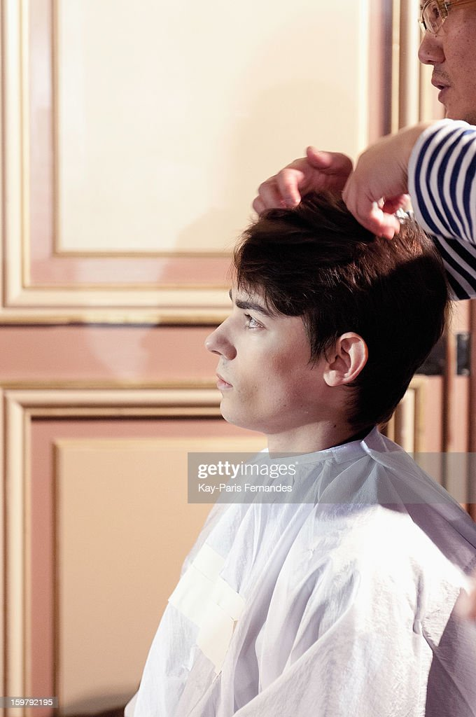 A model has his hair styled backstage during the Rynshu Men Autumn / Winter 2013 show as part of Paris Fashion Week on January 20, 2013 in Paris, France.