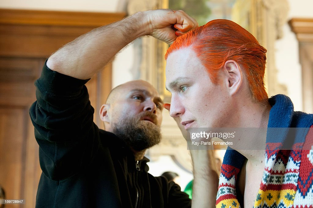 A model has his hair styled backstage during the Songzio Men Autumn / Winter 2013 show as part of Paris Fashion Week on January 19, 2013 in Paris, France.