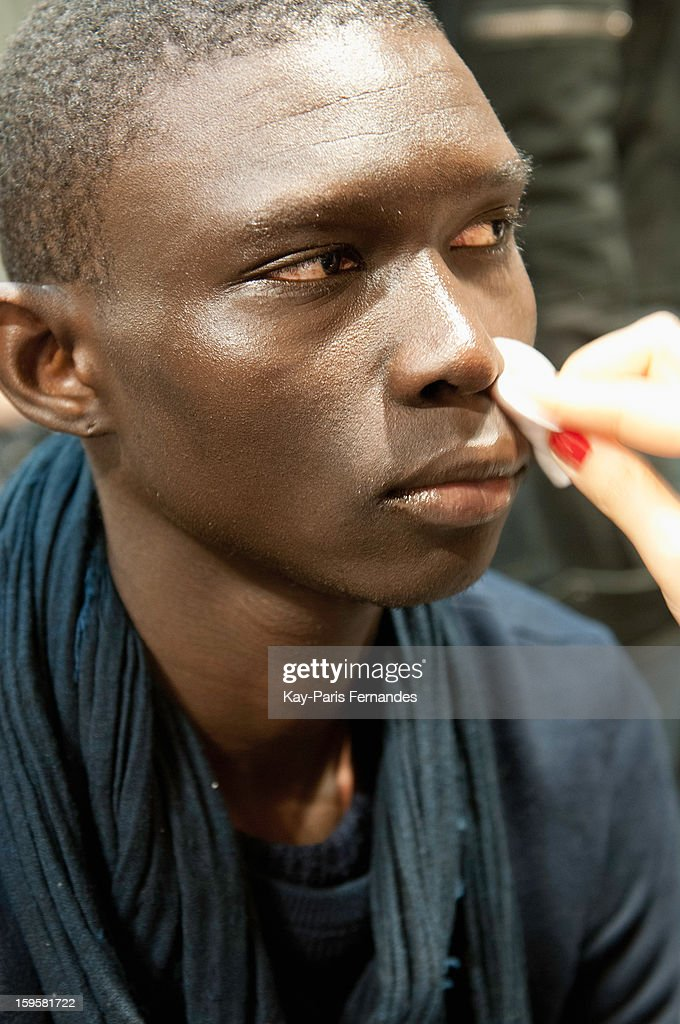 A model has his make-up done backstage during the John Lawrence Sullivan Men Autumn / Winter 2013 show as part of Paris Fashion Week on January 16, 2013 in Paris, France.