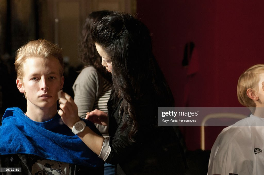 A model has his make-up done backstage during the Rynshu Men Autumn / Winter 2013 show as part of Paris Fashion Week on January 20, 2013 in Paris, France.
