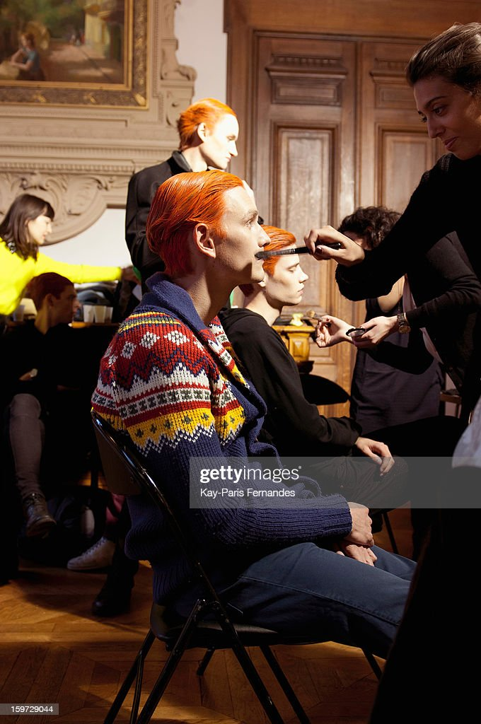 A model has his make-up done backstage during the Songzio Men Autumn / Winter 2013 show as part of Paris Fashion Week on January 19, 2013 in Paris, France.