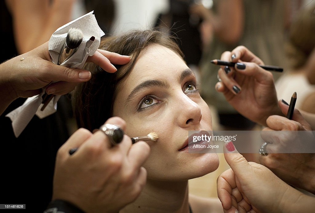 A model has make-up applied at the Yigal Azrouel spring 2013 fashion show during Mercedes-Benz Fashion Week at Highline Stages on September 7, 2012 in New York City.