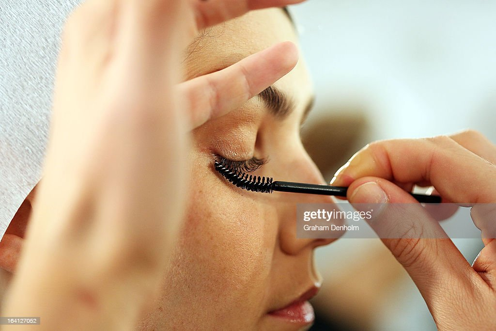 A model has makeup applied backstage prior to L'Oreal Paris Runway 1 during day three of L'Oreal Melbourne Fashion Festival at Docklands on March 20, 2013 in Melbourne, Australia.