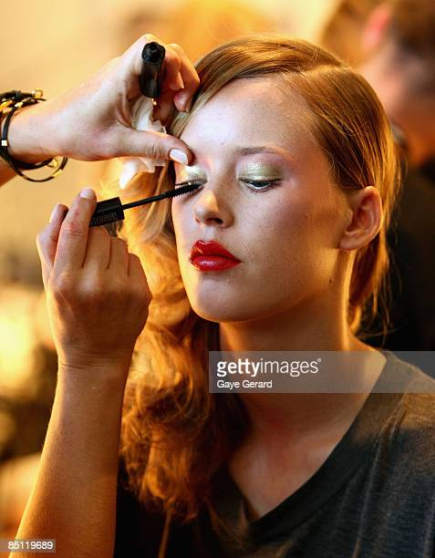 A model has makeup applied backstage prior to the Seventh Wonderland collection show during day two of Swim Fashion Week in Sanctuary Cove on...