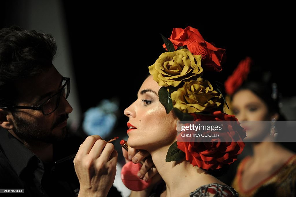 A model has make-up applied during the SIMOF 2016 (International Flamenco Fashion Show) in Sevilla, on February 6, 2016. AFP PHOTO/ CRISTINA QUICLER / AFP / CRISTINA QUICLER