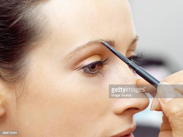 Model having eyebrow pencil applied