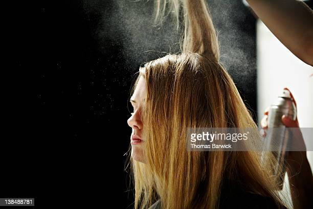 Model having hair done backstage at fashion show