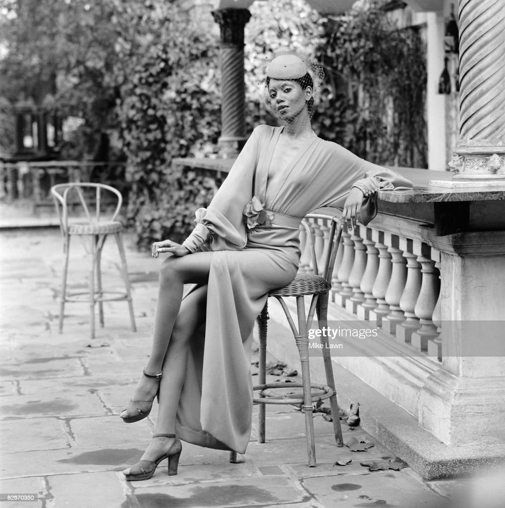 Model Hazel wearing an outfit by British designer John Bates at a fashion show at Les Ambassadeurs, London, 27th October 1972. The dress is in red crepe with matching pillbox hat and veil.