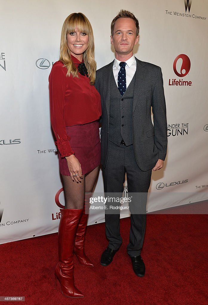 Model <a gi-track='captionPersonalityLinkClicked' href=/galleries/search?phrase=Heidi+Klum&family=editorial&specificpeople=178954 ng-click='$event.stopPropagation()'>Heidi Klum</a> and actor <a gi-track='captionPersonalityLinkClicked' href=/galleries/search?phrase=Neil+Patrick+Harris&family=editorial&specificpeople=210509 ng-click='$event.stopPropagation()'>Neil Patrick Harris</a> attend the 'Under The Gunn' Finale Fashion Show at Los Angeles Theatre on December 16, 2013 in Los Angeles, California.
